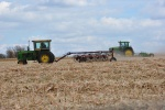 Tractors hard at work in Minnesota fields. - by Diane
