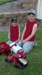 Great fun playing with tractors and trucks - by Jenny