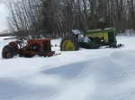 Tractors awaiting the arrival of spring - by Pam
