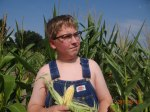 Autistic son picking the corn - by Kris M.